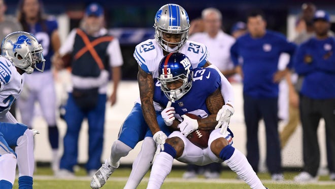 Sep 18, 2017; East Rutherford, NJ, USA; Giants receiver Odell Beckham is tackled by Lions cornerback Darius Slay in the first half at MetLife Stadium.