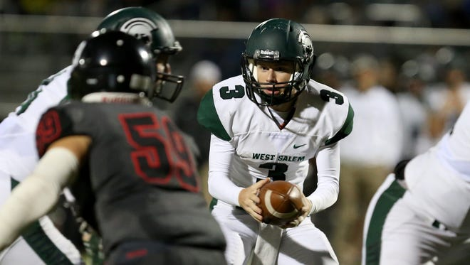 West Salem's Grant Thies (3) looks to hand off the ball in the West Salem vs. North Salem football game at North Salem High School on Friday, Sept. 29, 2017. West Salem won the game 48-7.