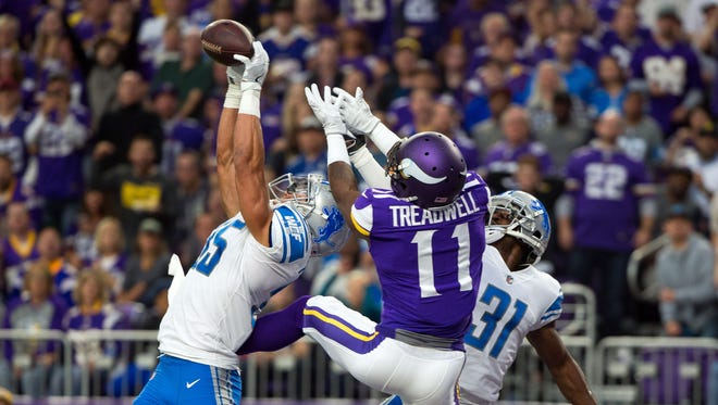 Lions safety Miles Killebrew (35) breaks up a pass to Vikings receiver Laquon Treadwell, as DJ Hayden also defends in the second quarter on Oct. 1 in Minneapolis.