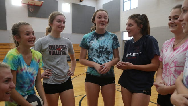 Foothill High School volleyball team members Ashley Lanzi, from left, Zoey Bishop, Carson Tarabochia-Martin, Sarah Ault, Jennifer Troxclair, Jenna Kritzer, and Kendall Renelle huddle up after practice Wednesday at the school in Palo Cedro.