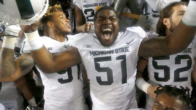 Michigan State #51 Kyonta Stallworth celebrates with teammates after beating Michigan 14-10 at Michigan Stadium in Ann Arbor on Sat., Oct. 7, 2017.