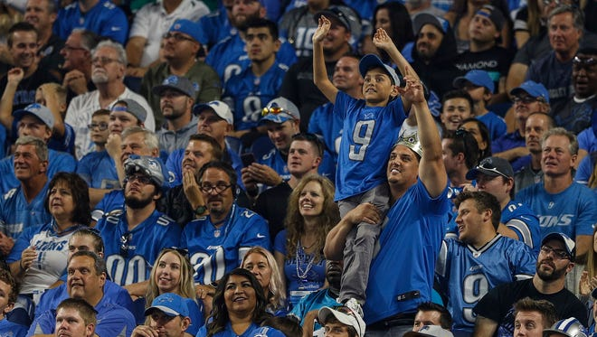 Detroit Lions fans cheer in the first half of the 27-24 loss to the Carolina Panthers at Ford Field in Detroit, Sunday, Oct. 8, 2017.