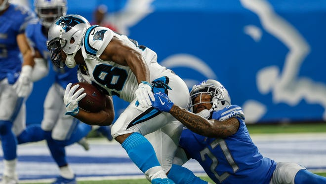Glover Quin tries to stop Jonathan Stewart in the first half of the Lions' 27-24 loss to the Carolina Panthers at Ford Field on Sunday, Oct. 8, 2017.