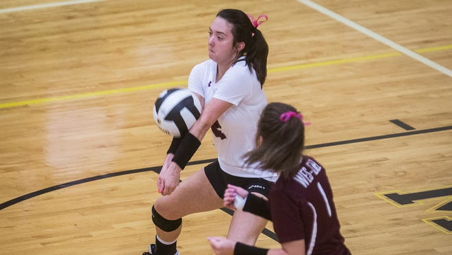 Wes-Del's Grace Bond, shown here against Cowan in the 2017 season, had 26 digs in a five-set win Monday.