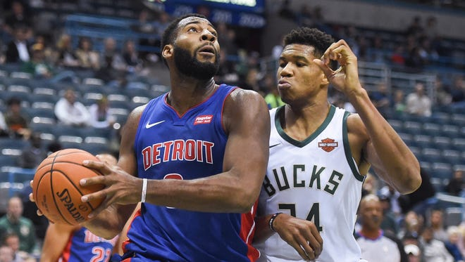 Pistons center Andre Drummond (0) drives for the basket against Bucks forward Giannis Antetokounmpo (34) in the first quarter on Friday, Oct. 13, 2017, in Milwaukee.