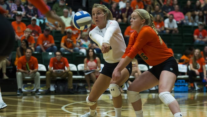 CSU sophomore defensive specialist Amanda Young, left, shown here in a match earlier this season, had 12 digs to lead the Rams over UNLV.