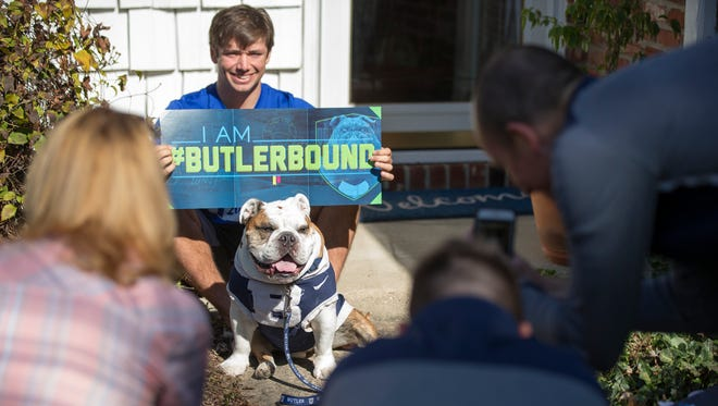 Nolan Brown, 17, and Butler University mascot Trip have their photo taken by Michael Kaltenmark, who's shown up to surprise the high school senior with acceptance to the Indianapolis university, Indianapolis, Thursday, October 19, 2017. Brown has applied to at least four schools, including Butler.