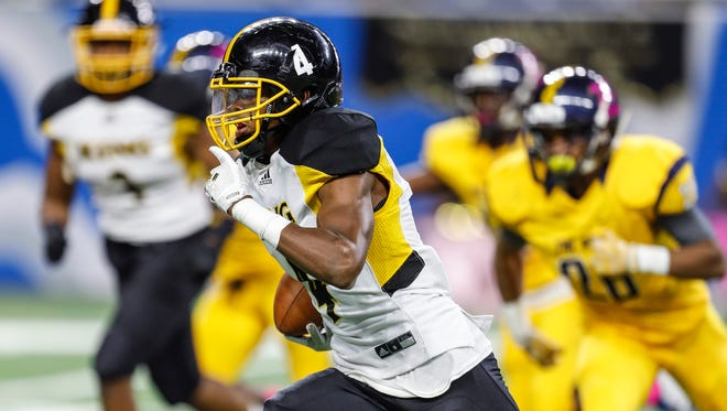 Detroit King's Marvin Grant returns a punt for a touchdown in the first half against East English Village during the Detroit Public School League championship game at Ford Field, Friday, October 20, 2017.