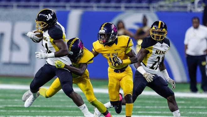 Detroit King's Jalen Jackson is tackled by East English Village's Cortez Berry during the Detroit Public School League championship game at Ford Field, Friday, October 20, 2017.
