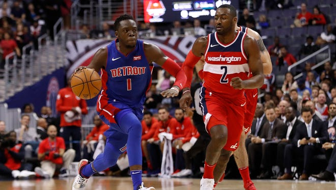 Pistons guard Reggie Jackson dribbles against Wizards guard John Wall in the first quarter at Capital One Arena on Friday, Oct 20, 2017 in Washington D.C.