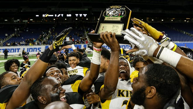 Detroit King players celebrate after winning the Detroit Public School League A championship over East English Village, 21-0, at the Ford Field, Friday, Oct. 20, 2017.