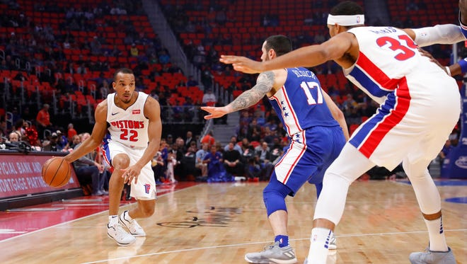 Detroit Pistons guard Avery Bradley (22) moves the ball defended by Philadelphia 76ers guard JJ Redick (17) in the first half at Little Caesars Arena.