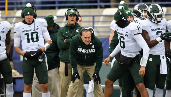 Michigan State head coach Mark Dantonio and QB Messiah deWeaver (10) look on in the first half against Northwestern at Ryan Field on Oct 28, 2017 in Evanston, Ill.