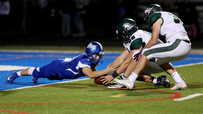 McNary's Ryan Bamford (4) fails to recover his fumble from West Salem's Sam McQuade (66) and Jonah Tinseth (34) in the West Salem vs. McNary football game at McNary High School in Keizer on Friday, Oct. 27, 2017. West Salem won the game 57-6.