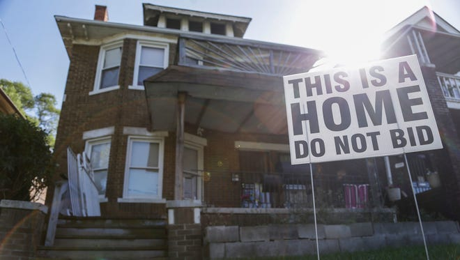 A sign is seen outside of Denise Tanks' house in Detroit, Wednesday, October 18, 2017.