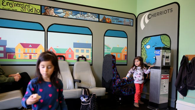 May Lucas, left, 5, and her sister, Ava Lucas, 2, both of Keizer, play in a new exhibit, Salem Station, at the Gilbert House Children's Museum in Salem on Thursday, Nov. 9, 2017. The transportation exhibit opened Nov. 3 and features equipments from Cherriots and Amtrak Cascades.
