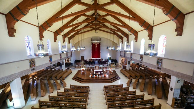 The sanctuary has a loft feel with exposed beams at Christ the King Catholic Church in Detroit on  Wed., Nov. 8, 2017.