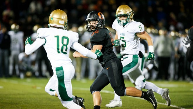 Sprague's Landon Davis (44) carries the ball in a second round OSAA 6A state playoff game against Jesuit on Friday, Nov. 10, 2017, at Sprague High School. At the end of the first half, Jesuit was leading by 35 to 0.