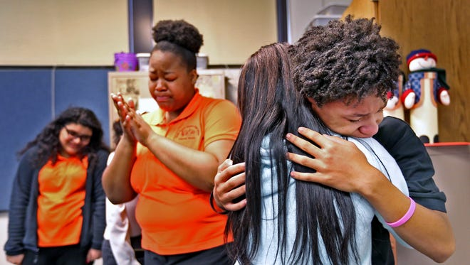 Anthony Glover, right, hugs classmate Kiya Demps after singing a gospel song during rehearsal of the Broad Ripple High School Choir, Thursday, Nov. 16, 2017.  The choir is raising money to perform in New York City in 2018.  They will be performing there as they celebrate their last year together.  The school is closing at the end of the school year.