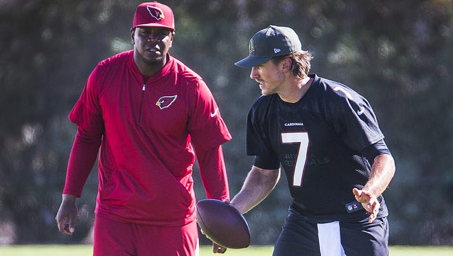 Arizona Cardinals quarterback Blaine Gabbert works with quarterbacks coach Byron Leftwich.