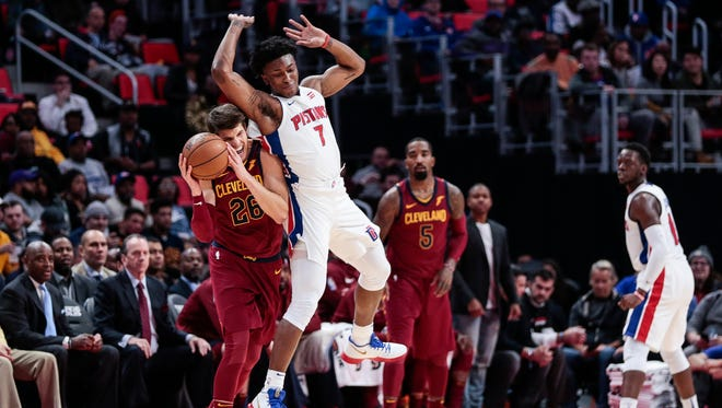 Pistons forward Stanley Johnson (7) fouls on Cavaliers forward Kyle Korver (26) during the first half on Monday, Nov. 20, 2017, at the Little Caesars Arena.