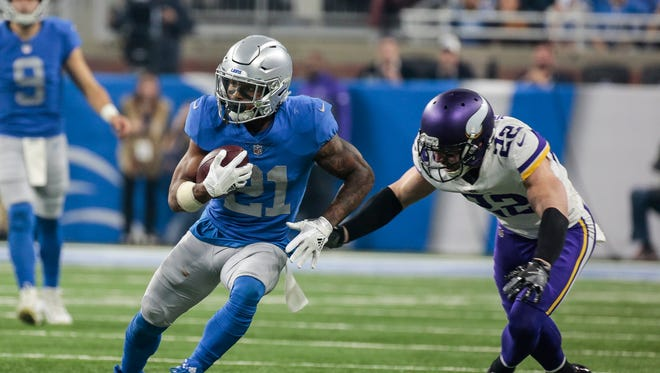 Lions running back Ameer Abdullah runs against Vikings safety Harrison Smith in the second half at Ford Field, Thursday, Nov. 23, 2017.
