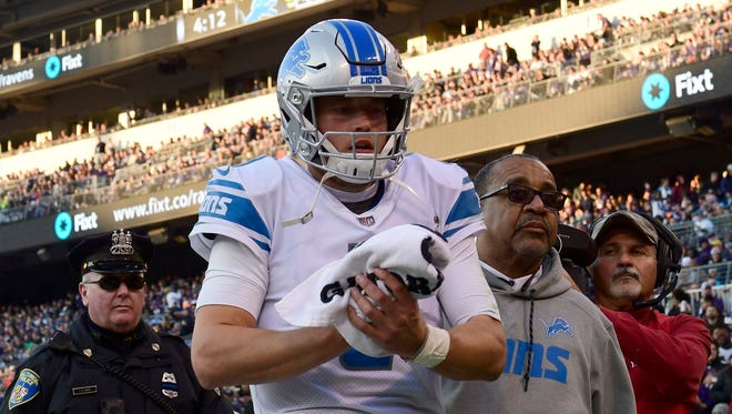 Lions quarterback Matthew Stafford leaves the game with his right hand wrapped with a towel late in the fourth quarter of the 44-20 loss to the Ravens at M&T Bank Stadium on Sunday, Dec. 3, 2017 in Baltimore, Md.