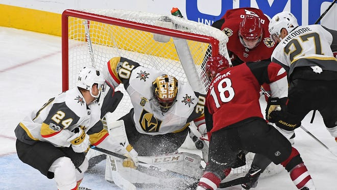 Dec 3, 2017: Vegas Golden Knights goalie Malcolm Subban (30) makes a save against Arizona Coyotes center Christian Dvorak (18) during the third period of play at T-Mobile Arena.