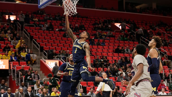 Michigan guard Charles Matthews makes a layup against Detroit Mercy during the second half of the Hitachi College Basketball Showcase at Little Caesars Arena in Detroit, Saturday, Dec. 16, 2017.