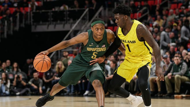 Michigan State's Cassius Winston dribbles against Oakland's Kendrick Nunn in the first half of the Hitachi College Basketball Showcase at Little Caesars Arena in Detroit, Saturday, Dec. 16, 2017.