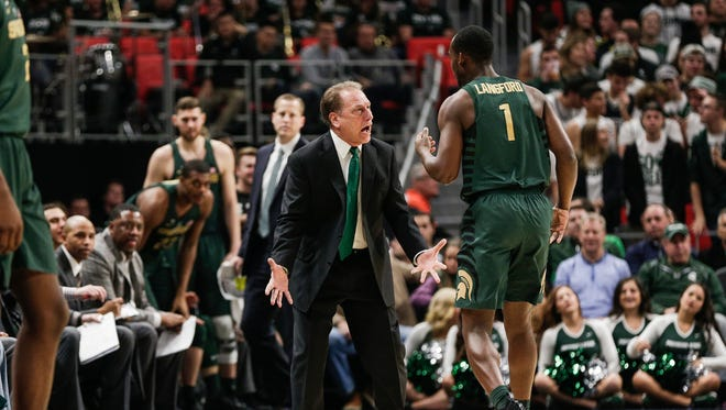 Michigan State head coach Tom Izzo talks to Joshua Langford during the first half of the Hitachi College Basketball Showcase against Oakland at Little Caesars Arena in Detroit, Saturday, Dec. 16, 2017.