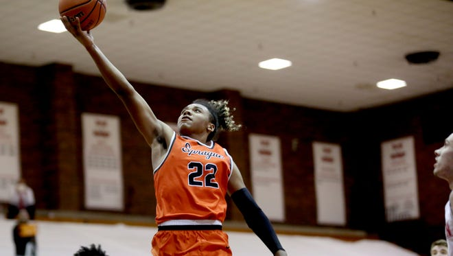 Sprague's Jailen Hammer (22) goes for two points in the Sprague vs. Lincoln basketball game in the first round of the Capitol City Classic at Willamette University in Salem on Tuesday, Dec. 19, 2017. Sprague won the game 81-74 in overtime.