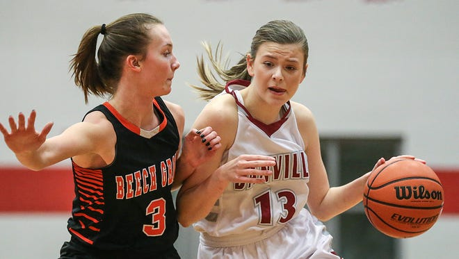 Beech Grove Hornets guard Cameron Cardenas (3) closely guards Danville Warriors Ella Collier (13) during first half action between the Danville Warriors and Beech Grove Hornets at Danville Community High School, Danville, Ind., Friday, Dec. 22, 2017. Danville won, 54-44.