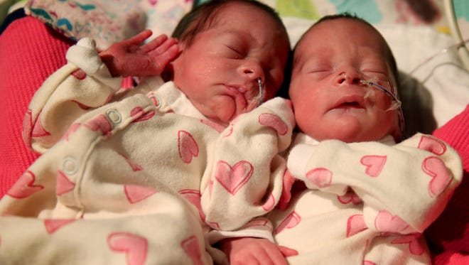 Aurora, left, and Phoenix, born Dec. 2, wear clothing made by inmates at the Coffee Creek Correctional Facility and Oregon Corrections Enterprises. The Thompson Bailey twins photographed at the Salem Health Neonatal Intensive Care Unit on Monday, Dec. 11, 2017.