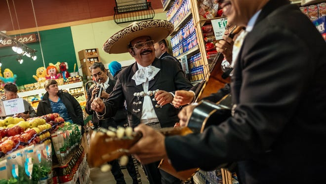 Salvador Torres and El Mariachi Mexico 2000 perform for shoppers at Honey Bee Market La Coleman in Mexicantown in Detroit during Cinco de Mayo on May 5, 2017.
