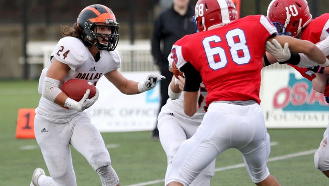 Dallas' Tanner Earhart (24) rushes in the first half of the Dallas vs. Lebanon OSAA Class 5A semifinal football game at Hillsboro Stadium on Saturday, Nov. 19, 2016. Lebanon won the game 10-7.