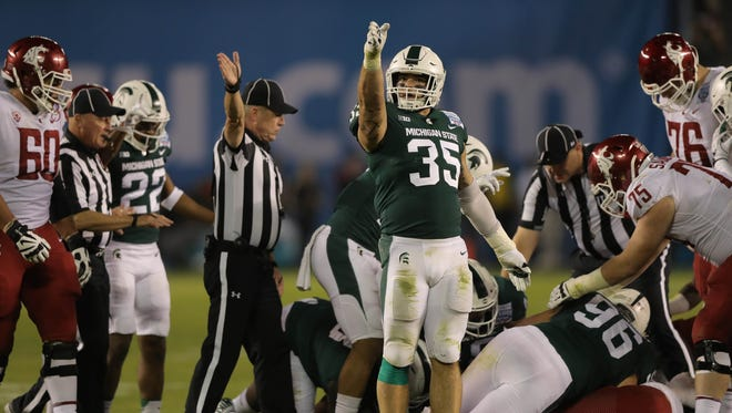 Joe Bachie celebrates a fumble by Washington State during the third quarter of Michigan State's 42-17 win in the San Diego County Credit Union Holiday Bowl on Dec. 28, 2017, in San Diego.