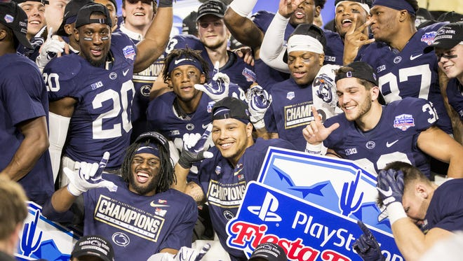 Penn State Nittany Lions players react following their win against the Washington Huskies in the 47th PlayStation Fiesta Bowl at University of Phoenix Stadium on Saturday, December 30, 2017 in Glendale, Arizona.