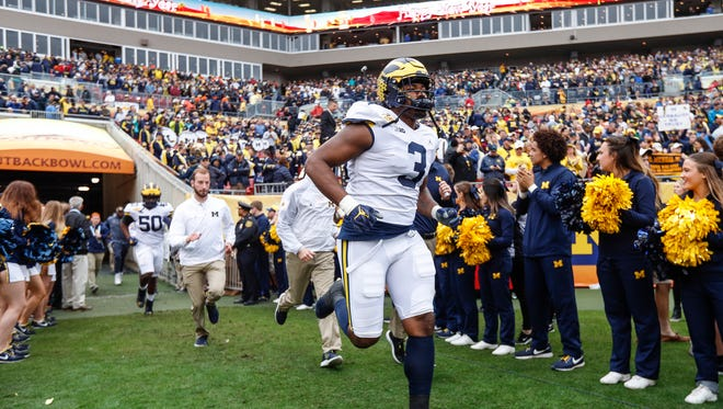 Rashan Gray runs onto the field before the Outback Bowl against South Carolina at in Tampa, Fla. on Jan. 1, 2018.