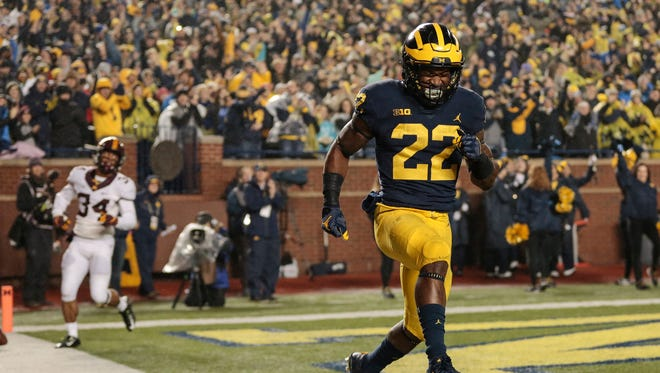 Michigan running back Karan Higdon celebrates after scoring a touchdown.