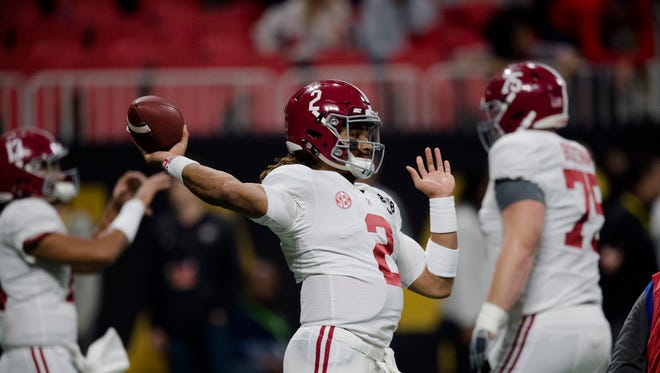 Alabama quarterback Jalen Hurts (2) throws a pass before the NCAA National Championship football game between Alabama and Georgia on Monday, Jan. 8, 2018, in Atlanta, Ga.