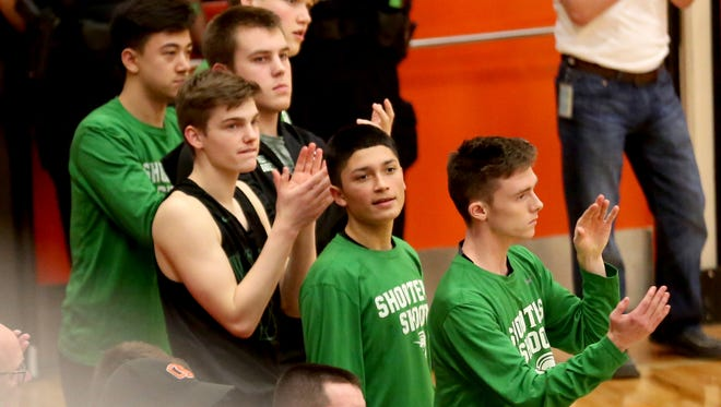 The West Salem bench reacts to a play in the first half of the West Salem vs. Sprague boys basketball game at Sprague High School in Salem on Tuesday, Jan. 9, 2018. Sprague won the game 66-53.