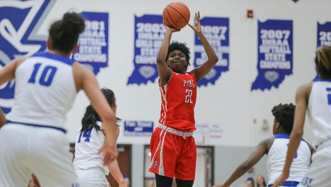Pike High School's Michaela White (22) hits a basket during a game at Hamilton Southeastern High School on Tuesday, Jan. 23, 2018. The Red Devils defeated Hamilton Southeastern 54 to 47. Amaya Hamilton (10), Molly Walton (14).