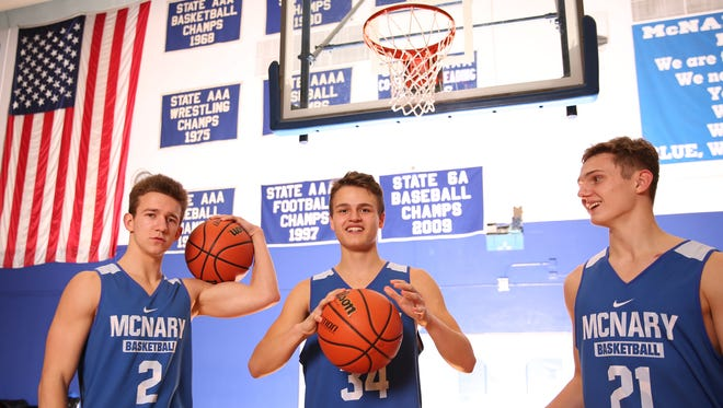 McNary boys basketball seniors Andrew Jones, from left, Chandler Cavell and Lucas Garvey, at McNary High School in Keizer on Thursday, Jan. 25, 2018.