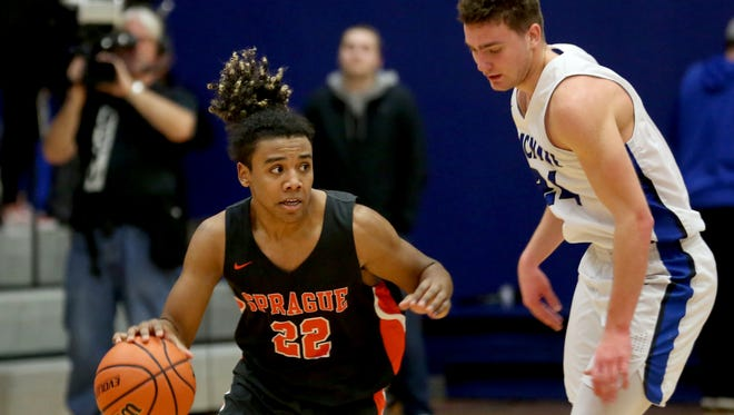 Sprague's Jailen Hammer (22) moves past McNary's Ricardo Gardelli (24) in the second half of the Sprague vs. McNary boys basketball game at McNary High School in Keizer on Friday, Jan. 26, 2018. Sprague won the game 56-47.