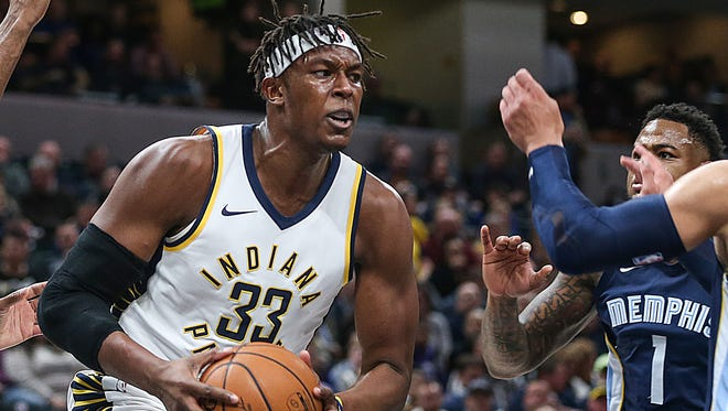 Indiana Pacers center Myles Turner (33) tries to break free from Memphis defenders under the basket, during first quarter game action between the Indiana Pacers and Memphis Grizzlies at Banker's Life Fieldhouse, Indianapolis, Wednesday, Jan. 31, 2018. The Pacers led at halftime, 55-53.