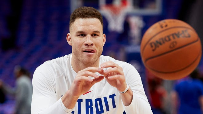 Blake Griffin smiles during warmups prior to his Pistons debut against the Grizzlies at Little Caesars Arena on Thursday.
