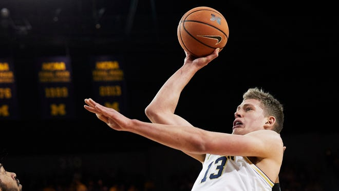 Feb 3, 2018; Ann Arbor, MI, USA; Michigan Wolverines forward Moritz Wagner shoots in the first half against the Minnesota Golden Gophers at Crisler Center.