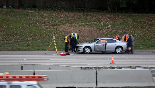 Emergency personnel manage the scene after a person jumped onto I-5 southbound from the Center Street overpass in Salem on Thursday, Feb. 15, 2018.