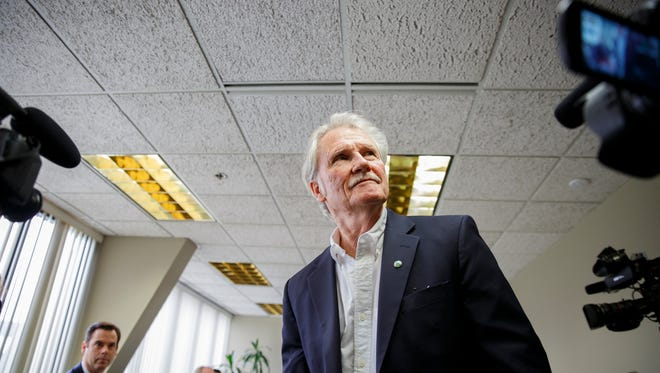Former Gov. John Kitzhaber enters the room before the Oregon Government Ethics Commission voted whether he violated state ethics laws 11 times while in office. Photographed at the Oregon Government Ethics Commission in Salem on Friday, Feb. 16, 2018.